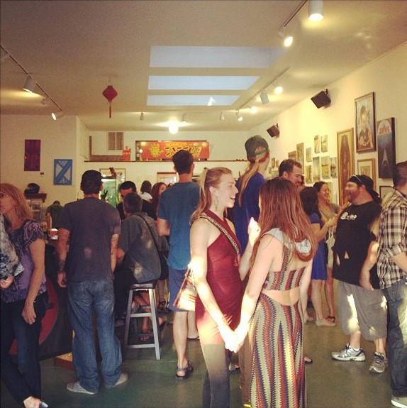 A very full gallery art opening at Buddha's Palm!